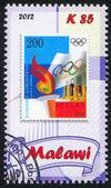 Fakkel en de Olympische vlag — Stockfoto