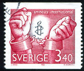 Amnesty International emblem — Stock Photo