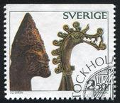 Viking head of carved bone — Stock Photo