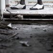 Legs in ruined room — Stock Photo
