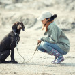 Stock Photo: Dog and tamer