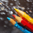Stock Photo: Three color pencils under rain