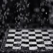 Chessboard under rain — Stock Photo #39618549