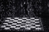 Chessboard under the rain — Stock Photo