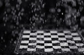 Chessboard under the rain — Stock Photo