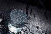 Water glass on a wet table — Stock Photo
