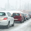 Traffic jam in the city at winter time — Stock Photo