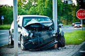 Wrecked car after hitting a lamp post — Stock Photo
