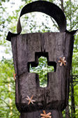Wooden cross part of the tombstone in a cemetery — Photo