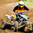 Quad rider in championship race — Stock Photo