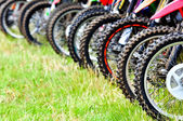 Motocross riders lined up before start on the race — Stock Photo