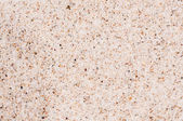 Coarse sand background texture. Macro of coarse sand grains — Stock Photo