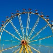 Big wheel with multicolored cabins in amusement park  — Stock Photo