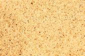 Coarse sand background texture. Macro of coarse sand grains — Stock Photo