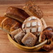 Group of different breads type on wooden table — Stock Photo