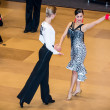 Competitors dancing latin dance on conquest — Stock Photo #38667595