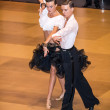 Competitors dancing latin dance on conquest — Stock Photo #38667673