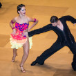 Competitors dancing latin dance on conquest — Stock Photo #38667899