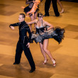 Competitors dancing latin dance on conquest — Stock Photo #38668159