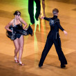Competitors dancing latin dance on conquest — Stock Photo #38668245