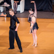 Competitors dancing latin dance on conquest — Stock Photo #38668461