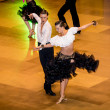 Competitors dancing latin dance on conquest — Stock Photo #38668645