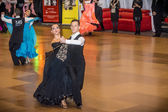 Competitors dancing slow waltz on the dance conquest — Stockfoto