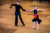 Competitors dancing latin dance on the conquest — Stockfoto