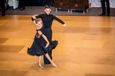 Competitors dancing latin dance on the conquest — ストック写真