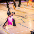 Stock Photo: Competitors dancing latin dance on conquest