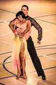 Competitors dancing latin dance on the conquest — Stock Photo