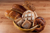 Group of different bread's type on wooden table — Foto de Stock