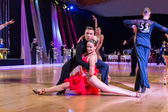 Dancers dancing latin dance on the dance conquest — Stock Photo
