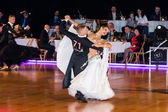 Dancers dancing slow waltz on  the dance conquest — Stock Photo