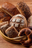 Group of different bread's type on wooden table — ストック写真