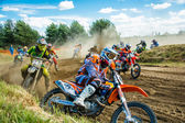 Motocross riders on the race — Stock Photo