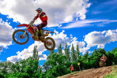 Motocross rider on the race — Stock Photo