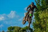 Motocross rider on the race — Stock Photo