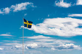Swedish flag on sky background — Stock Photo