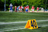 American football game with out of focus players in the background  — Stock Photo