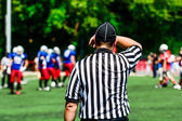 Umpire judging the game of American football — Stock Photo