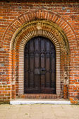 Old door of medieval Cistercian monastery in Kolbacz, Poland — Stockfoto