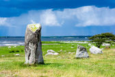 Stone blocks on the meadow at strom time — Stock Photo
