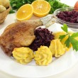 Stock Photo: Duck drumstick with red cabbage