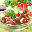 Tomato, mozzarella and ham skewers with basil — Stock Photo