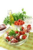 Fresh delicious Tomato, mozzarella and ham skewers — Stock Photo
