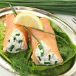 Stuffed smoked salmon rolls — Stock Photo