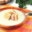 Fresh Cream of celery soup with salmon croutons — Stock Photo