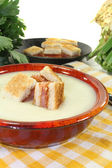 Cooked Cream of celery soup with salmon croutons — Stock Photo