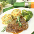 Venison medallions with rosemary branch — Stock Photo